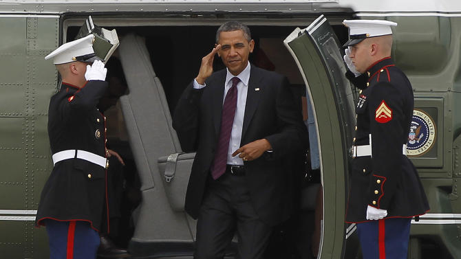 President Barack Obama returns a salute as he steps off the Marine One helicopter prior to boarding Air Force One at Los Angeles International Airport in Los Angeles, Friday, May 11, 2012. (AP Photo/Pablo Martinez Monsivais)