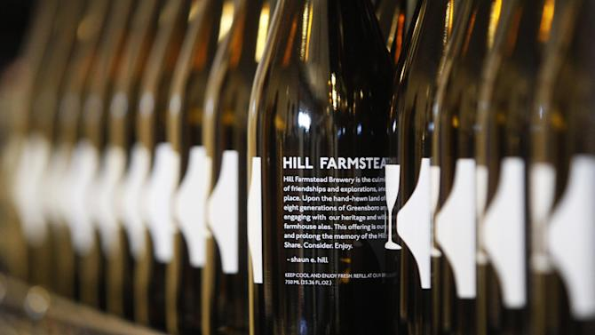 In this Wednesday, April 3, 2013 photo, bottles of fresh-brewed beer line a shelf at Hill Farmstead Brewery in Greensboro, Vt. Vermonters are buzzing about beer, and with good reason. The craft brew world has noticed that the small New England state better known for its cheeses and maple syrup also happens to make killer beer. In fact, one brewery, Hill Farmstead Brewery, has been rated the world's best brewer on a popular international consumer review website called RateBeer.com. (AP Photo/Toby Talbot)