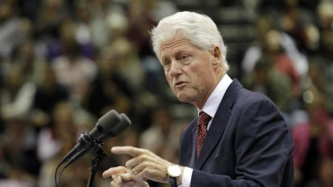 """Former President Bill Clinton speaks at a """"Hoosier Common Sense"""" rally for Indiana Democratic Senate candidate Joe Donnelly and Indiana Democratic gubernatorial candidate John Gregg in Indianapolis, Friday, Oct. 12, 2012.  (AP Photo/Michael Conroy)"""