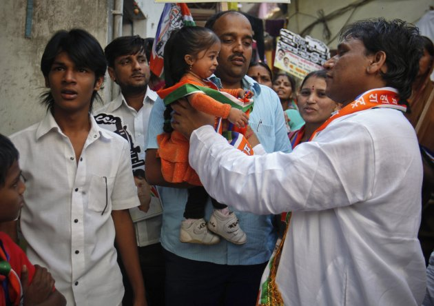 Amge, the world's shortest woman, is carried by supporter of MNS as she campaigns for the upcoming municipal elections in Mumbai