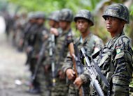 Moro Islamic Liberation Front (MILF) rebels are seen standing guard inside camp Darapanan, Sultan Kudarat town, Maguindanao province, on southern island of Mindanao, on October 27, 2012. Philippine President Benigno Aquino will next week make a historic visit to the stronghold of MILF in an effort to push forward peace talks, his office confirmed on Thursday