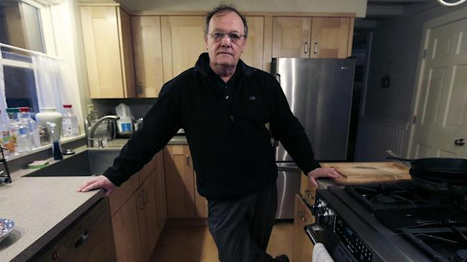 In this  Friday, Feb. 15, 2013, photo, Robert Sprague poses in the kitchen of his  Wilmot, N.H. home.  Sprague a  marketing consultant wants to put an end to Gun raffles. (AP Photo/Charles Krupa)