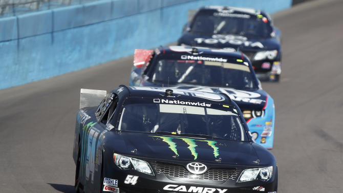 Kyle Busch, front leads Austin Dillon, center, and Parker Kligerman into Turn 1 during the NASCAR Nationwide Series auto race Saturday, March 2, 2013, at Phoenix International Raceway in Avondale, Ariz.(AP Photo/Paul Connors)