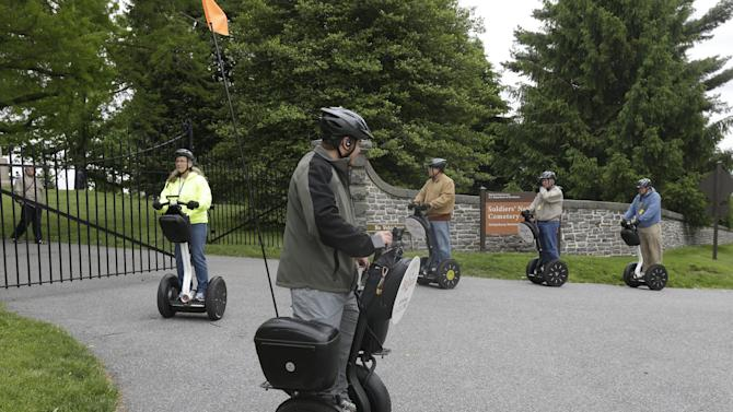 In this Friday, May 24, 2013 photo, visitors riding Segways tour Gettysburg National Military Park, in Gettysburg, Pa.  Tens of thousands of visitors are expected for the 10-day schedule of events that begin June 29 to mark 150th anniversary of the Battle of Gettysburg that took that took place July 1-3, 1863.  (AP Photo/Matt Rourke)