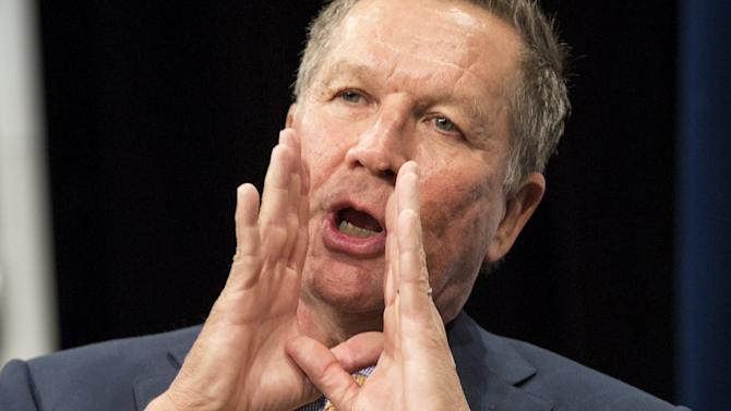 Republican presidential candidate Gov. John Kasich gestures as he answers questions during an interview with the United States Hispanic Chamber of Commerce in Washington