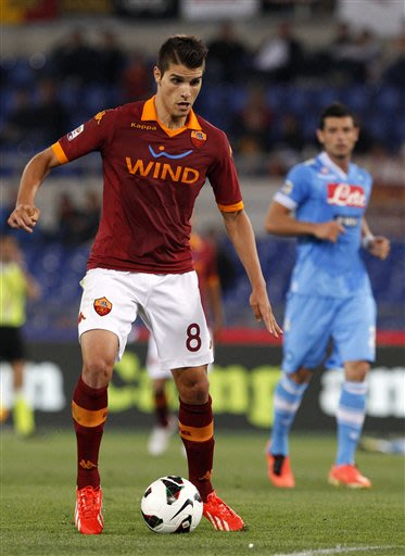 AS Roma forward Erik Lamela, of Argentina, controls the ball during a Serie A soccer match between AS Roma and Napoli, at Rome's Olympic stadium, Sunday, May 19, 2013
