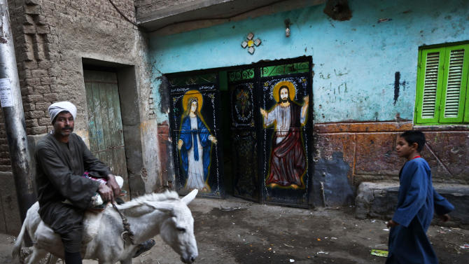 In this Tuesday, Dec. 18, 2012 photo, a man rides on a donkey in the village of El-Aziyah near the city of Assiut, southern Egypt. After a campaign of intimidation by Islamists, most Christians in this southern Egyptian province were too afraid to participate in last week's referendum on an Islamist-drafted constitution they desperately oppose, residents say. Some of the few who dared try to reach polls were pelted by stones. The disenfranchising hikes Christians' worries over their future under Egypt's empowered Islamists, but some young members of the community are starting to push back.(AP Photo/Petr David Josek)