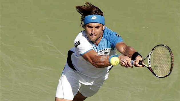 David Ferrer of Spain hits a backhand to Jurgen Melzer of Austria their quarter-final match at the Sony Open tennis tournament in Key Biscayne, Florida March 27, 2013. REUTERS