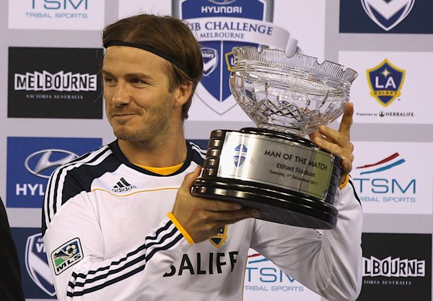 MELBOURNE, AUSTRALIA - DECEMBER 06: David Beckham of the Galaxy poses with the man of the match trophy during the friendly match between the Melbourne Victory and LA Galaxy at Etihad Stadium on December 6, 2011 in Melbourne, Australia. (Photo by Quinn Rooney/Getty Images)