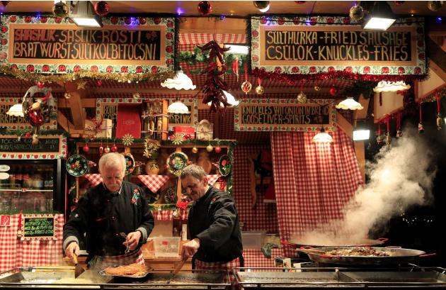 Vendors prepare food at the Budapest Christmas Fair at Vorosmarty square in downtown Budapest