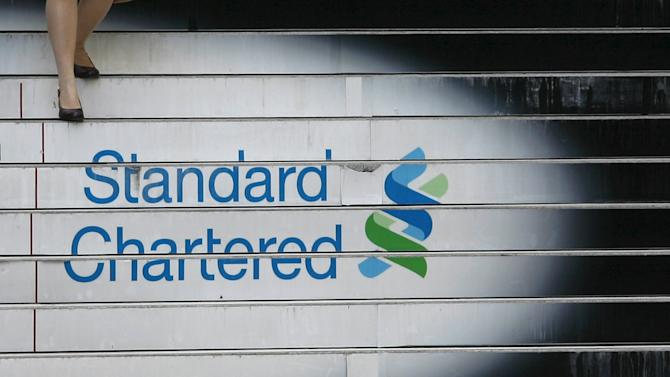 File photo of a woman walking down the stairs of the Standard Chartered headquarters in Hong Kong