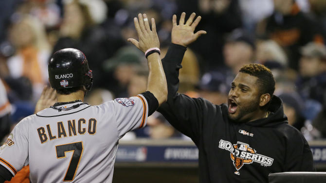 San Francisco Giants' Gregor Blanco is congratulated by Pablo Sandoval after scoring during the second inning of Game 3 of baseball's World Series against the Detroit Tigers Saturday, Oct. 27, 2012, in Detroit. (AP Photo/Matt Slocum)
