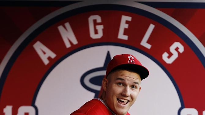 Los Angeles Angels' Mike Trout runs through the dugout to prepare for a baseball game against the Los Angeles Dodgers on Thursday, Aug. 7, 2014, in Anaheim, Calif. (AP Photo/Alex Gallardo)