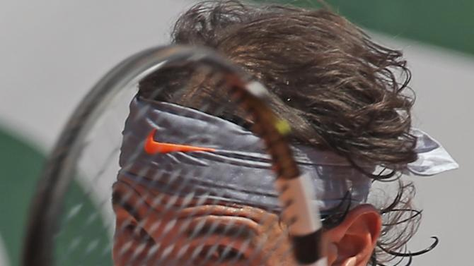 Spain's Rafael Nadal returns against Serbia's Novak Djokovic in their semifinal match at the French Open tennis tournament, at Roland Garros stadium in Paris, Friday June 7, 2013. (AP Photo/Michel Euler)