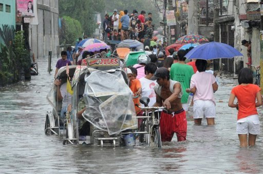 Residents in Navotas in suburban Manila in August after Typhoon Saola. Another powerful typhoon, Bopha, barrelled towards the Philippines Monday, prompting nearly 8,000 people to leave their homes in coastal and low-lying areas, officials said.