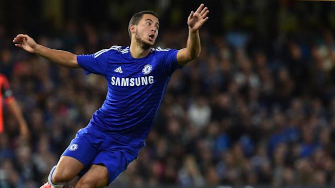 Chelsea midfielder Eden Hazard chases the ball during the pre-season football friendly against Real Sociedad at Stamford Bridge in London on August 12, 2014
