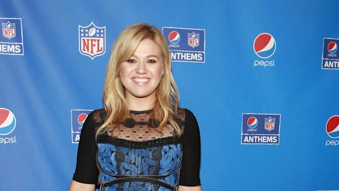 NFL Anthems Artist Kelly Clarkson at the Pepsi NFL Anthems Kickoff Eve event on Tuesday, Sept. 4, 2012, at the Hard Rock Cafe in New York. (Photo by Mark Von Holden/Invision for Hard Rock International/AP Images)