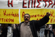 """<p> A state school teacher shouts slogans, in front of a banner that reads """"No to The Civil Mobilization"""" during a peaceful protest in central Athens on Monday, May 13, 2013. Greece's conservative-led government has issued a civil mobilization order forcing state school teachers to work during university entrance exams later in May. Teachers' unions had been planning strikes during the exams, to protest planned increases in working hours and involuntary staff transfers _ as part of the financially-distressed country's austerity and reform program. (AP Photo/Kostas Tsironis)"""