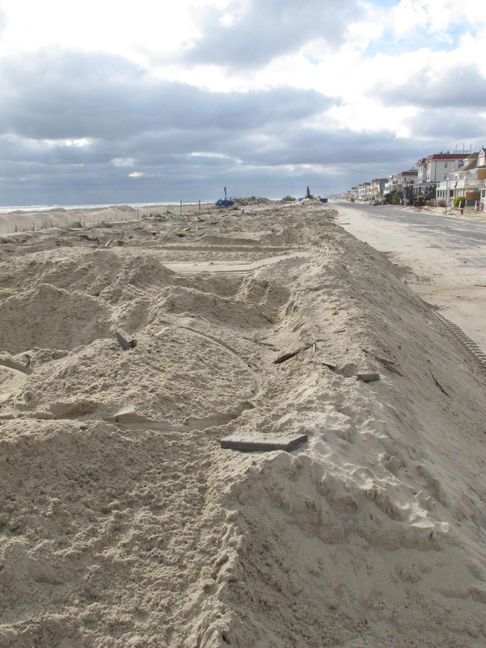Piles of sand are all that remain where the Belmar N.J. boardwalk used to stand, in a Nov. 15, 2012 photo. Superstorm Sandy took a bite out of the Jersey shore, washing away millions of tons of sand and slimming down beaches along the state's 127-mile coastline. (AP Photo/Wayne Parry)