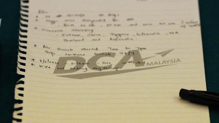 A note is seen on the table where Malaysia's DCA officials were seated, during their meeting with a group sent by the Chinese government after the disappearance of Malaysia Airlines flight MH370, at Kuala Lumpur International Airport