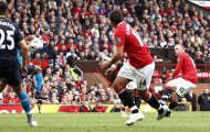 Manchester United's Wayne Rooney, right, scores a goal from a free kick against Arsenal during their English Premier League soccer match at Old Trafford, Manchester, England, Sunday Aug. 28, 2011. (AP Photo/Jon Super)