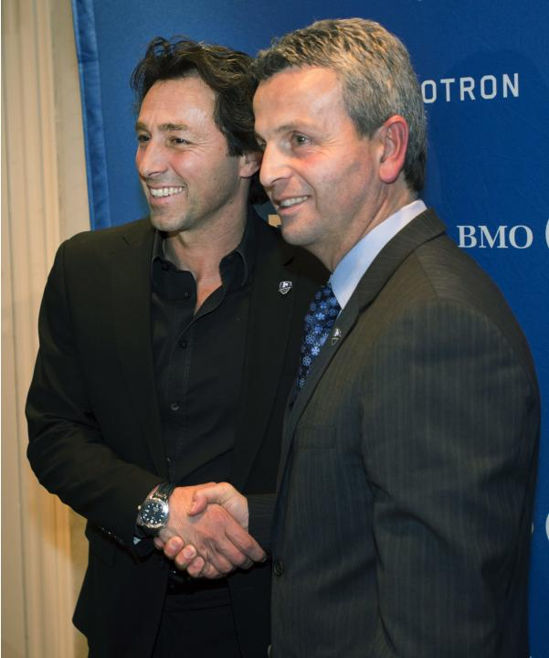 New Montreal Impact soccer head coach Frank Klopas, right, shakes hands with sporting director Nick Di Santis after a news conference on Wednesday, Dec. 18, 2013, in Montreal