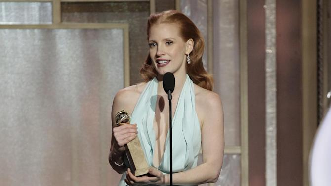 """This image released by NBC shows Jessica Chastain with her award for best actress in a motion picture drama for her role in """"Zero Dark Thirty"""" during the 70th Annual Golden Globe Awards at the Beverly Hilton Hotel on Jan. 13, 2013, in Beverly Hills, Calif.  (AP Photo/NBC, Paul Drinkwater)"""