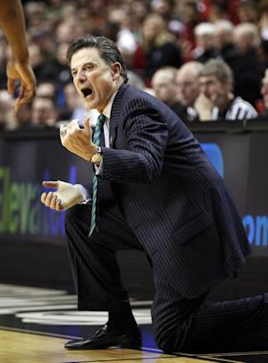 Louisville head coach Rick Pitino shouts to his team in the first half of an NCAA college basketball tournament third-round game with New Mexico, in Portland, Ore., Saturday, March 17, 2012. (AP Photo/Rick Bowmer)