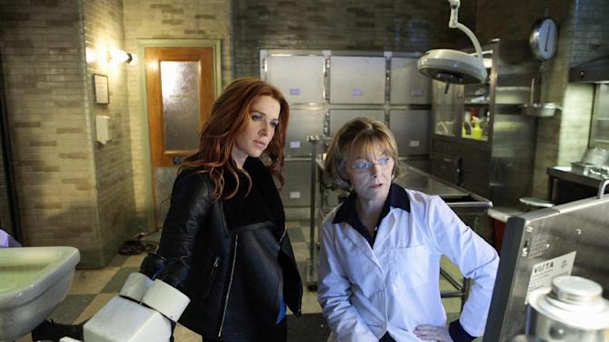 """In this undated image released by CBS, Poppy Montgomery, left, and Jane Curtin are shown in a scene from """"Unforgettable.""""  (AP Photo/CBS, Giovanni Rufino)"""
