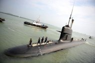 A French-made Malaysian submarine it reaches its naval base in Port Klang on the outskirts of Kuala Lumpur in 2009. A scandal linking Malaysia&#39;s leader, a young woman&#39;s murder and alleged kickbacks in a French submarine deal has resurfaced as a potential danger for the government as elections loom