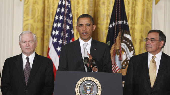 President Barack Obama stands with outgoing Defense Secretary Robert Gates, left, and Defense Secretary-nominee Leon Panetta, in the East Room of the White House in Washington, Thursday, April 28, 2011, as he introduced his reworked reworked national security team . (AP Photo/Charles Dharapak)