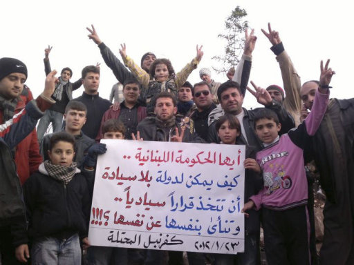 Demonstrators gather during a protest against Syria's President Bashar al-Assad in Kafranbel, near Idlib