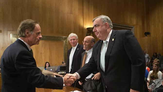Senate Homeland Security and Governmental Affairs Committee Chairman Sen. Tom Carper, D-Del., left, greets witnesses on Capitol Hill in Washington, Wednesday, July 10, 2013, before the start of the committee's hearing to review lessons learned from the Boston Marathon bombings. Witnesses, from right to left are, Boston Police Commissioner Edward Davis III, Kurt Schwartz, undersecretary for homeland security and emergency management in the Massachusetts Executive Office of Public Safety, and Deputy Federal Emergency Management Agency Administrator Richard Serino. (AP Photo/J. Scott Applewhite)