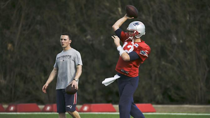 New England Patriots quarterback Tom Brady (12) passes during practice Wednesday, Jan. 28, 2015, in Tempe, Ariz. The Patriots play the Seattle Seahawks in NFL football Super Bowl XLIX Sunday, Feb. 1, in Glendale, Ariz