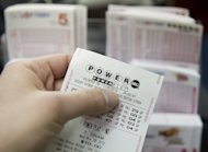 A Powerball lottery ticket is seen in a convenience store in Washington in November 2012. A lucky player in Arizona has claimed the second winning ticket in the US Powerball lottery&#39;s near-record jackpot of $587.5 million, organizers said