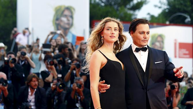"""Actor Johnny Depp and his wife Amber Heard attend the red carpet event for the movie """"Black Mass"""" at the 72nd Venice Film Festival"""