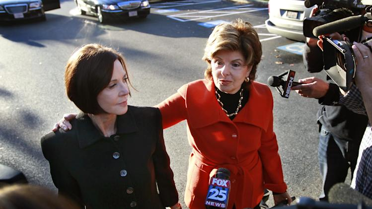 CORRECTS NAME TO MAUREEN SULLIVAN STEMBERG, NOT MAUREEN STEMBERG SULLIVAN - Maureen Sullivan Stemberg, left, ex-wife of Staples founder Tom Stemberg, and her lawyer Gloria Allred, right, face members of the media as they arrive at Norfolk County Probate Court Thursday, Oct. 25, 2012, in Canton, Mass. Lawyers for The Boston Globe are to return to court Thursday to argue for the public release of testimony given by GOP presidential candidate Mitt Romney in the divorce of Stemberg. Stemberg's ex-wife and Allred and told the judge in the case they do not object to lifting the impoundment order on Romney's testimony. (AP Photo/Steven Senne)