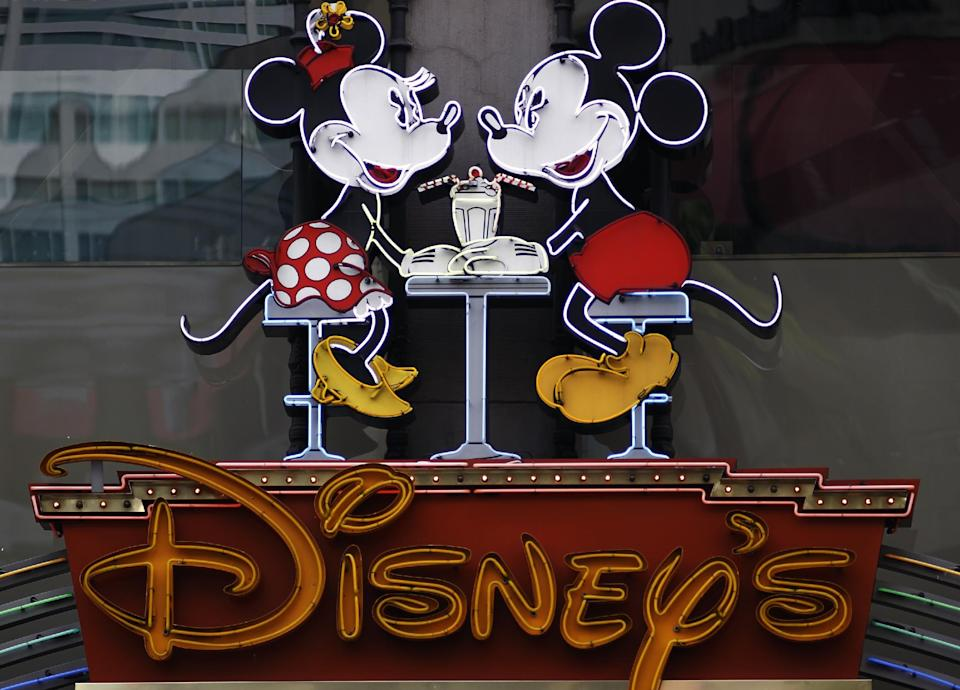 In this Feb. 6, 2012 photo, The Disney Soda Fountain & Studio Store marquee is seen on Hollywood Boulevard in Los Angeles. Walt Disney Co. releases quarterly financial earnings Tuesday, Feb. 7, 2012, after the market close. (AP Photo/Damian Dovarganes)