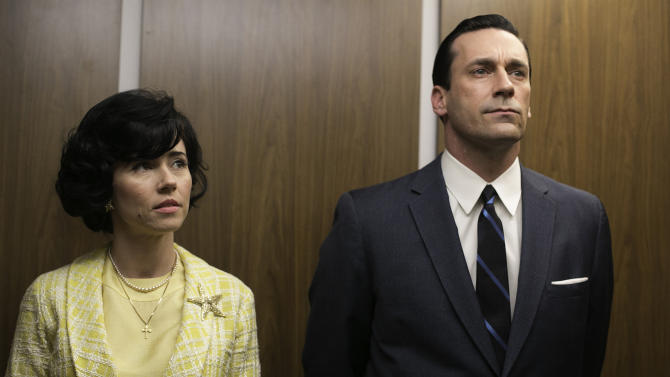 """This TV publicity image released by AMC shows Linda Cardellini as Sylvia Rosen, left, and Jon Hamm as Don Draper in a scene from """"Mad Men."""" The season finale airs Sunday, June 23, on AMC. (AP Photo/AMC, Jordin Althaus)"""