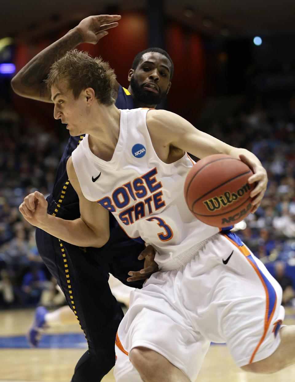 Boise State guard Anthony Drmic (3) drives past La Salle guard Ramon Galloway in the first half of a first-round game of the NCAA college basketball tournament, Wednesday, March 20, 2013, in Dayton, Ohio. (AP Photo/Al Behrman)