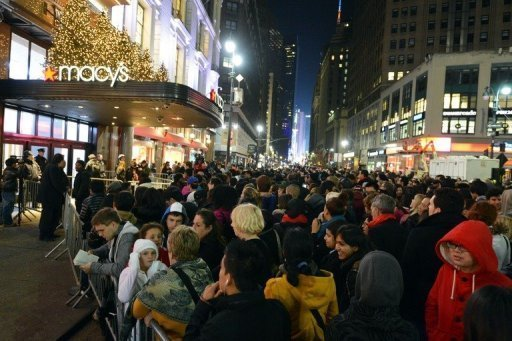 "<p>Crowds gather outside Macy's department store in New York on November 22 in advance of the midnight November 23 opening to start the ""Black Friday"" shopping weekend. Frenzied consumers across the US swarmed stores early Friday snapping up deals and kicking off the holiday shopping season with what businesses hoped would be a bang.</p>"