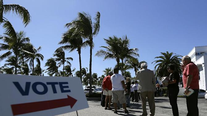 FILE - This Oct. 29, 2012 file photo shows people standing in line to vote in the presidential election, in Miami. There's always grousing about people who don't bother to vote. But look at it another way: An estimated 133 million Americans will cast ballots in Tuesday's election. That's about 6 in 10 eligible adults. Some will persevere despite long lines, pressing personal burdens or the devastation left by Superstorm Sandy. Why do they do it? It's not because any one voter will decide the contest between President Barack Obama and Mitt Romney. Depending on which state they live in, the odds of casting a deciding vote for president are somewhere between 1 in a million and essentially zero. (AP Photo/Lynne Sladky, File)