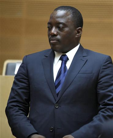 DRC's President Kabila arrives at the signing ceremony of the peace deal to end eastern Congo conflict, in Addis Ababa