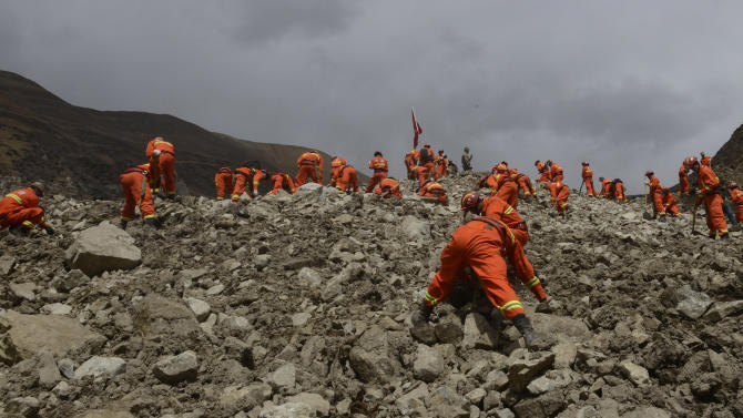 Slim chance of life after Tibet mudslide buries 83