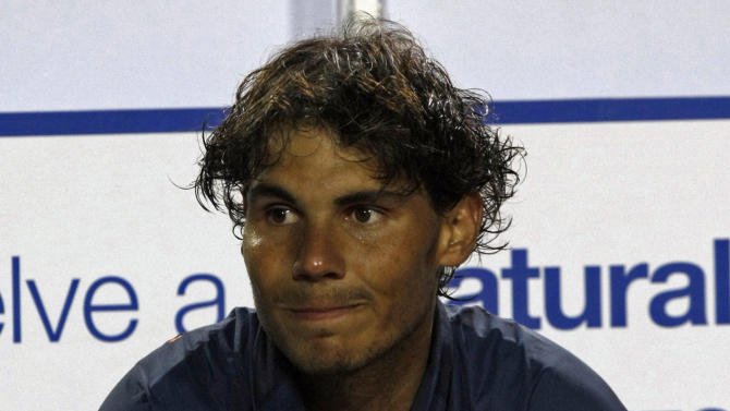 Spain's Rafael Nadal sits at the end of the VTR Open final tennis game against Argentina's Horacio Zeballos in Vina del Mar, Chile, Sunday, Feb. 10, 2013. Nadal lost to Zeballos 6-7 (2), 7-6 (6), 6-4 in Sunday's final of the VTR Open, the Spaniard's comeback tournament after seven months out with a torn tendon in his left knee. (AP Photo/Luis Hidalgo)
