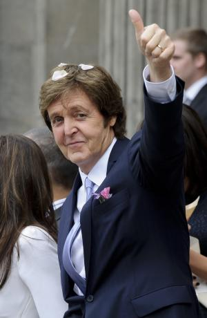 FILE - In this Oct. 9, 2011 file photo, former Beatle Paul McCartney gestures as he and American heiress Nancy Shevell leave Marylebone Town Hall, London, after their wedding. McCartney is going to help restore an 1877 Steinway grand piano used by Motown greats. On Monday, Oct. 31, 2011, the piano will be picked up from the Detroit museum and shipped to Steinway & Sons in New York for restoration. The work is expected to take up to five months. (AP Photo/Jonathan Short, File)