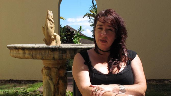 """Kimberlyn Scott speaks with a reporter in Makawao, Hawaii, on Wednesday, July 16, 2014. Scott's daughter, Carly """"Charli"""" Scott, went missing in February and has not been seen since. Her former boyfriend has been charged with murdering her and burning her vehicle. (AP Photo/Oskar Garcia)"""