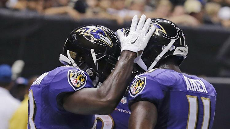 Baltimore Ravens wide receiver Deonte Thompson (83) celebrates his touchdown reception with wide receiver Kamar Aiken (11) and running back Lorenzo Taliaferro (34) during the first half of an NFL preseason football game against the New Orleans Saints in New Orleans, Thursday, Aug. 28, 2014