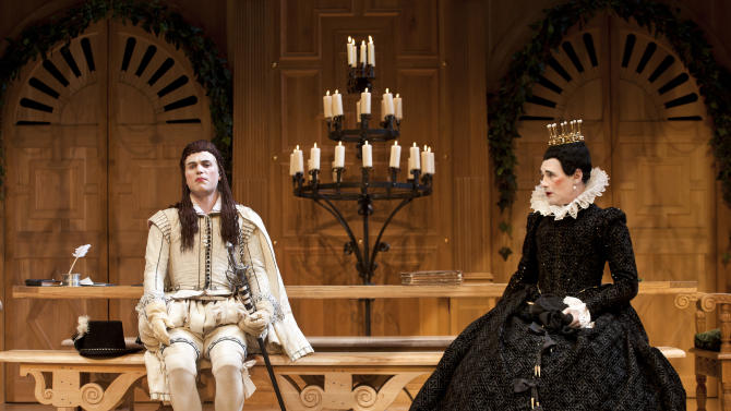 """In this image provided on Monday Nov. 19, 2012 by Sonia Friedman Productions, Mark Rylance, as the character Olivia, right, and Johnny Flynn, as the character Viola, perform during a rehearsal of """"Twelfth Night"""" at a London theatre, Nov. 1, 2012. Mark Rylance's latest London performances are hot tickets, and not just because he is one of Britain's leading Shakespearean actors. It's a chance to see him in two wildly contrasting roles, the scheming usurper dispatching everyone who stands between him and the throne in """"Richard III,"""" and the aloof countess Olivia, blindsided by love, in the boisterous comedy """"Twelfth Night."""" (AP Photo/Simon Annand, Sonia Friedman Productions)"""