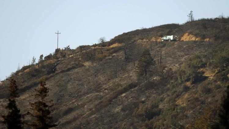 National Forest fire truck drives along Pfeiffer Ridge that was scorched during a wildfire in Big Sur